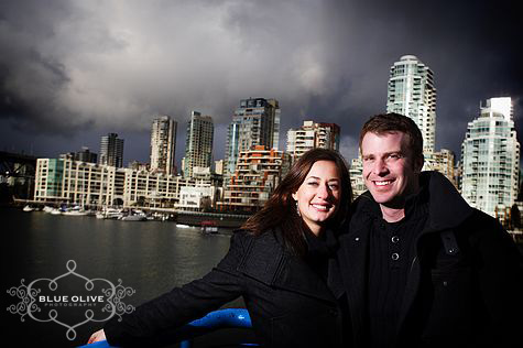 Granville island Vancouver skyline engagement photo